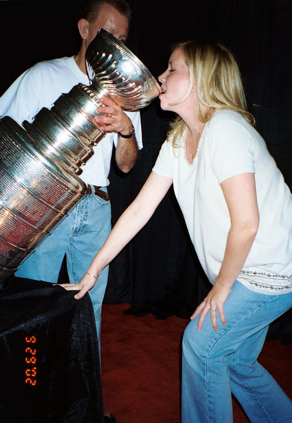 Jennifer drinking shanpagne from the Stanley Cup