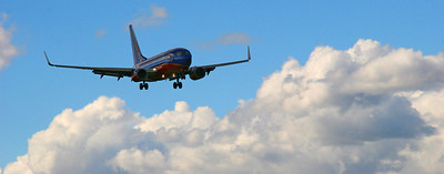 Incoming flight at Burbank Airport, from blue skies above the clouds to raining beneath.