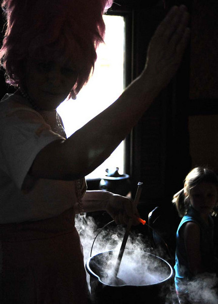 Boil, boil, toil and trouble, cauldron boil and flamingo hair.  A kitchen witch at work.