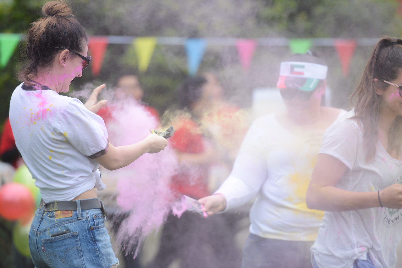 Maddalena Farniati throws powder at Ladaijha Owens during the Holi Festival, Saturday, March 10, 2018, in Chico, California. (Carin Dorghalli -- Enterprise-Record)