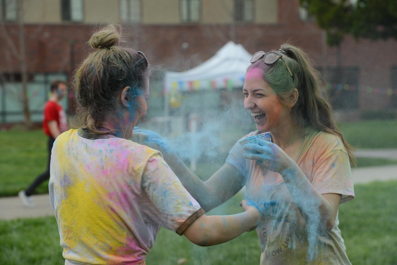 Marissa Mcinerny and Maddalena Farniati throw colored powder at each other during the Holi Festival, Saturday, March 10, 2018, in Chico, California. (Carin Dorghalli -- Enterprise-Record)
