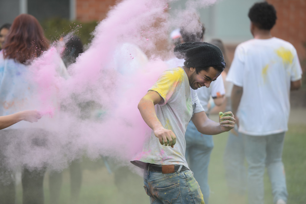 . People throw colored powder at each other during the Holi Festival, Saturday, March 10, 2018, in Chico, California. (Carin Dorghalli -- Enterprise-Record)
