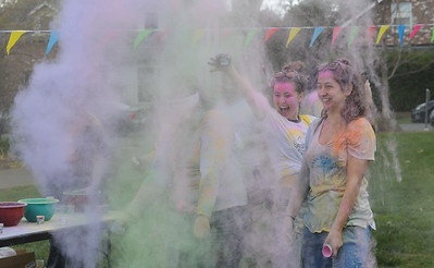 Ladaijha Owens, Maddalena Farniati and Marissa Mcinerny throw colored powder in the air during the Holi Festival, Saturday, March 10, 2018, in Chico, California. (Carin Dorghalli -- Enterprise-Record)