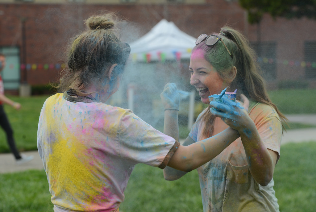 . Marissa Mcinerny and Maddalena Farniati throw colored powder at each other during the Holi Festival, Saturday, March 10, 2018, in Chico, California. (Carin Dorghalli -- Enterprise-Record)