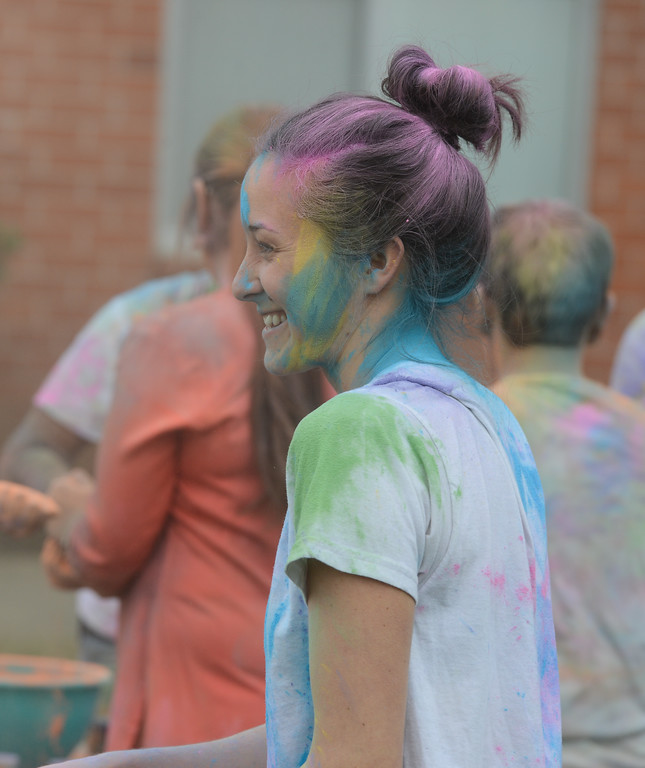. Lauren Piasecki enjoys the Holi Festival, Saturday, March 10, 2018, in Chico, California. (Carin Dorghalli -- Enterprise-Record)