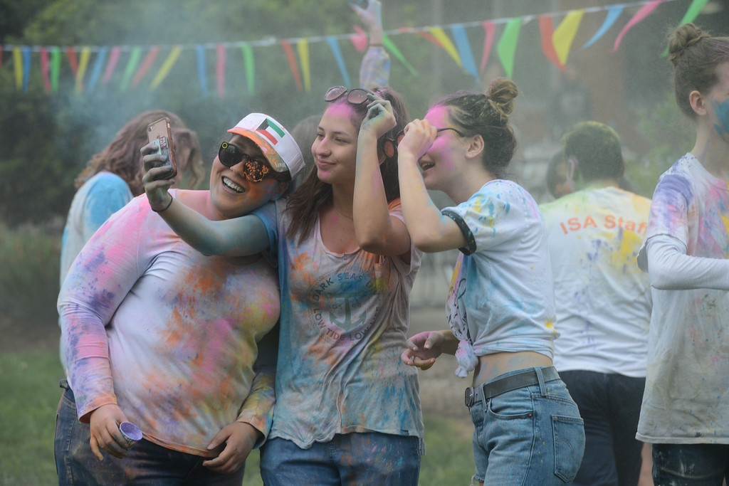 . Ladaijha Owens, Marissa Mcinerny and Maddalena Farniati take a selfie during the Holi Festival, Saturday, March 10, 2018, in Chico, California. (Carin Dorghalli -- Enterprise-Record)