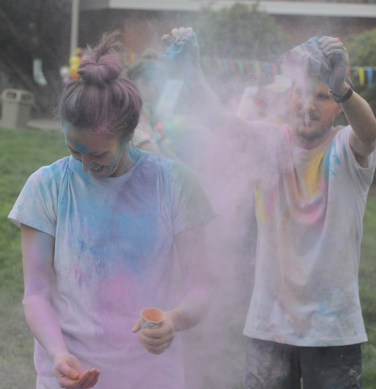 . Alex Piasecki throws colored powder at his wife, Lauren, during the Holi Festival, Saturday, March 10, 2018, in Chico, California. (Carin Dorghalli -- Enterprise-Record)