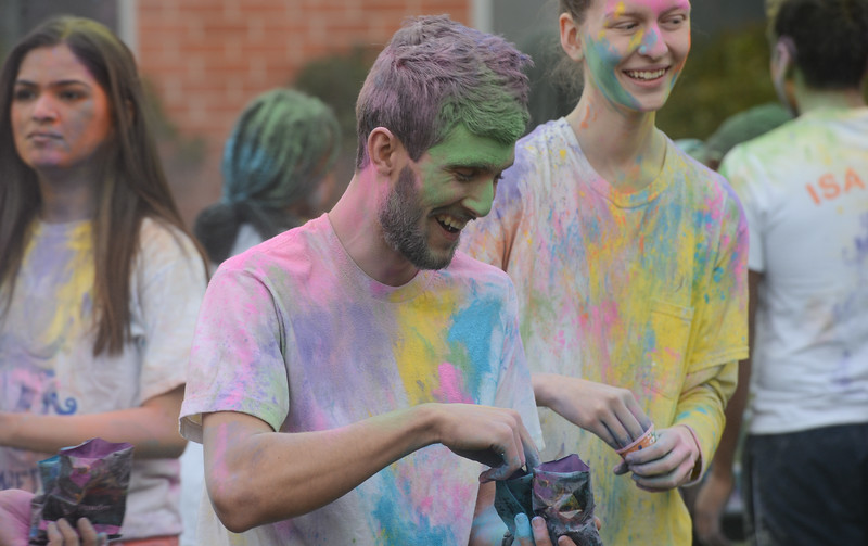 Alex Piasecki gets ready to throw colored powder during the Holi Festival, Saturday, March 10, 2018, in Chico, California. (Carin Dorghalli -- Enterprise-Record)