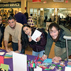 students signing cards for troops at bookstore event