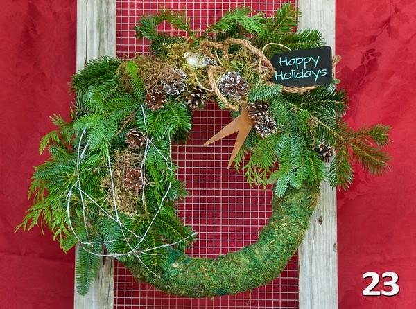 "#23 - 16"" moss round wreath with fresh PNW greens & chalkboard tag."