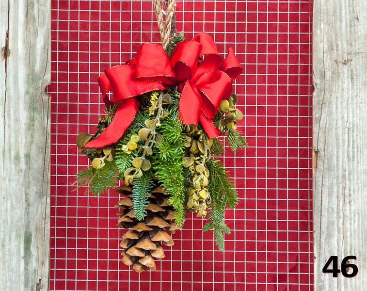 #46 - Kissing cone. Sugar pine cone wth bow, fresh PNW greens and locally harvested mistletoe. A unique way to get kisses this holiday season!