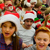 "KRISTOPHER RADDER - BRATTLEBORO REFORMER<br /> Dummerston School students rehearse ""Holiday Heroes"" on Tuesday, Dec. 5, 2017. People can attend the holiday show at 6:30 p.m. on Wednesday, Dec. 6, at the Dummerston School gym.  The message of the show is about giving during the holiday season."