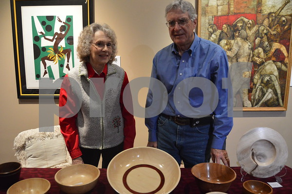 Doyle Wilson and his wife show off some of the wooden bowls created at CW Bowls.