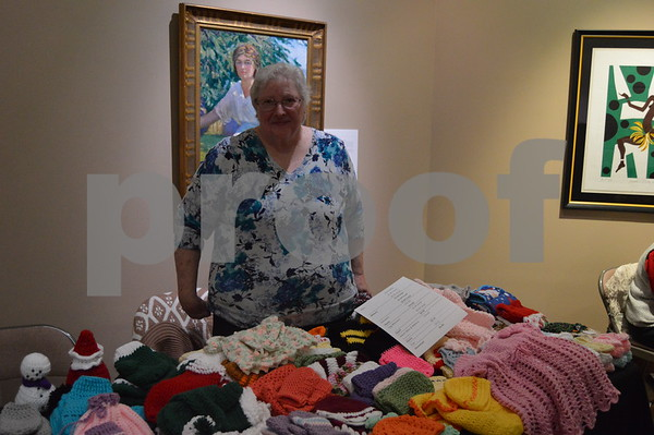 Sharon Balm showed off some of her original knitted pieces at the holiday event.