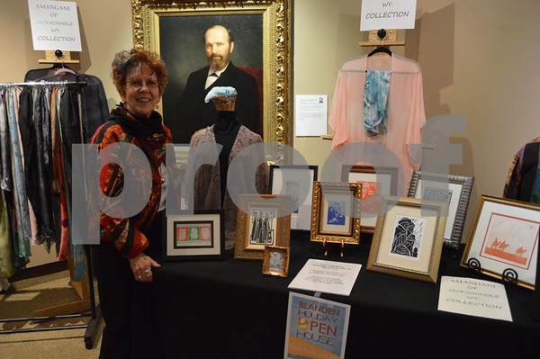 Pam Sanders of Pam's Prints N Silks shows off some of her silk work and pressings.