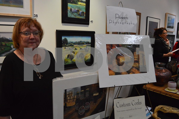 Maureen Powers of Powers Photography & Design displayed and sold prints of her original photography.