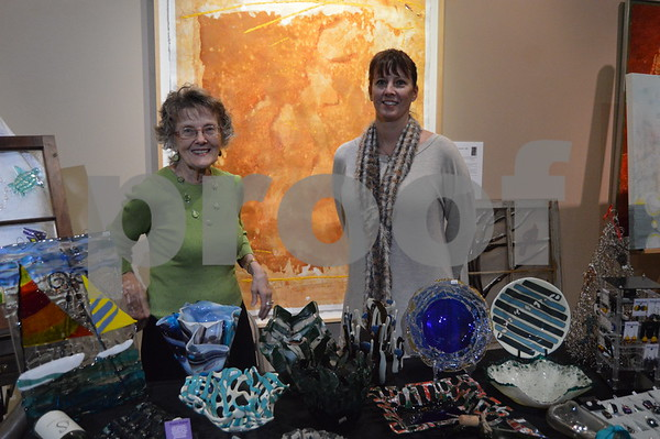 Heather Applegate of Studio Fusion shows off some of her intricate glass work, accompanied by her mother Sonja Bloomquist.