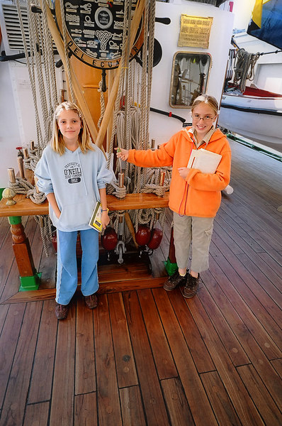 Emily with her friend Amelia, on the deck of the sailing ship Guyas, in San Francisco Bay.