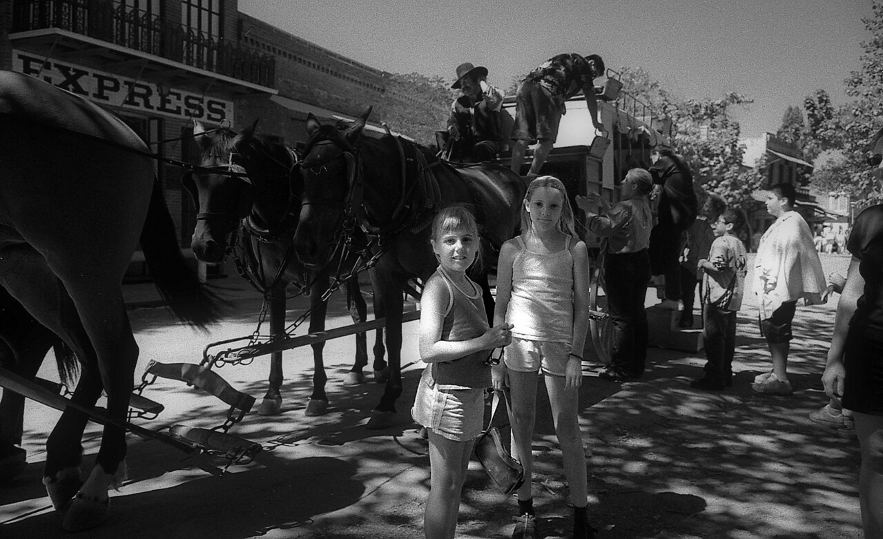 The girls next to an old stagecoach, in historic Columbia, CA (in Gold Country)
