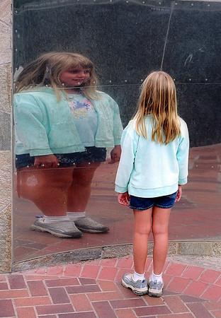 Elena - crazy mirrors at the zoo.