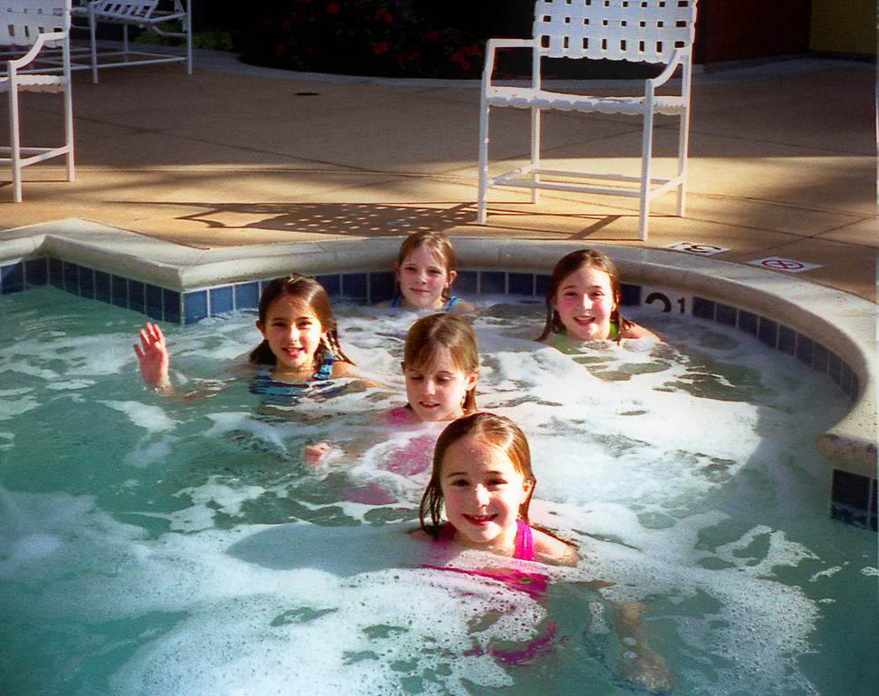 The hotel hot tub. Natalie is front and center; Daniela, Emily, Elena and Kelly are lurking behind.