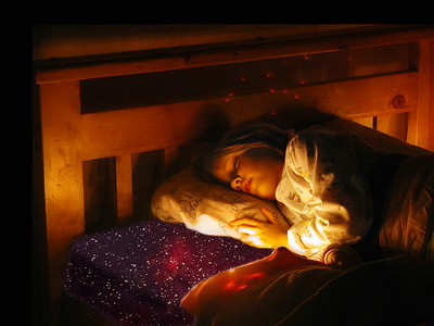 Emily sleeps peacefully, to the sound of the Laughing Stars.