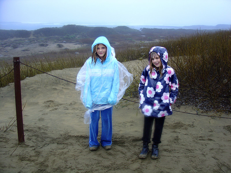 It was just pouring. You can see that Emily and Elena were prepared. Not.