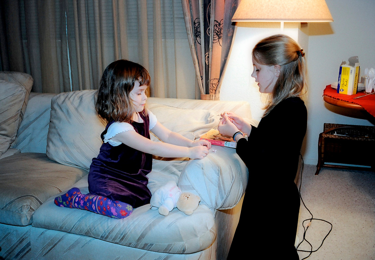Emily with Claire. What is she teaching her??