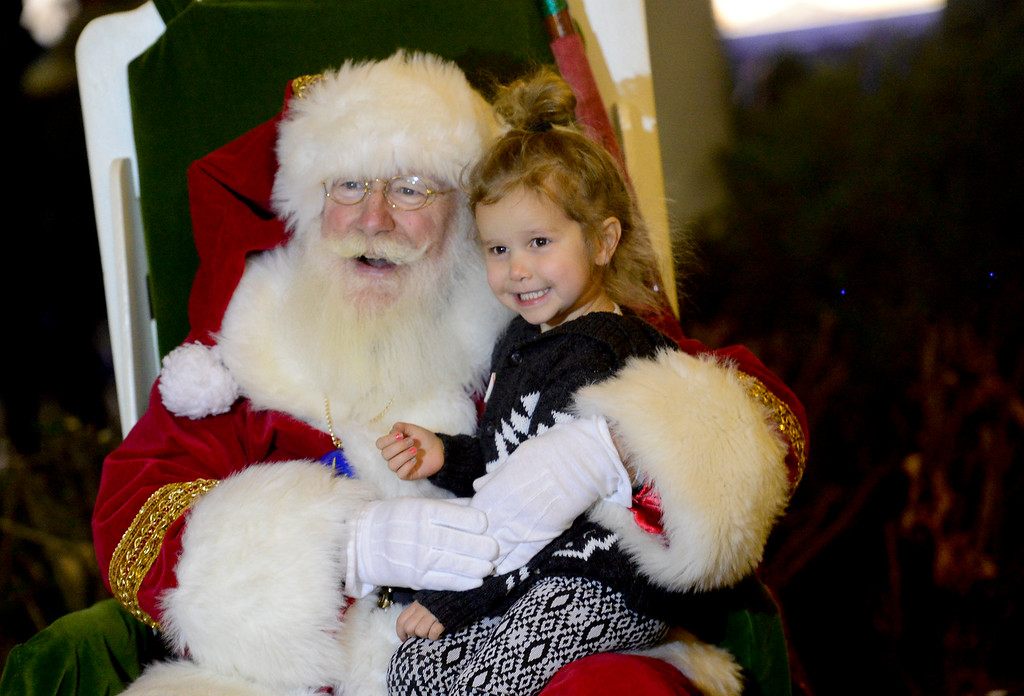 . Ada Frazier, 3, of Longmont, smiles as she has her photo taken with Santa Claus before the annual tree lighting in Longmont, Colorado on Nov. 24, 2017. (Photo by Matthew Jonas/Times-Call)