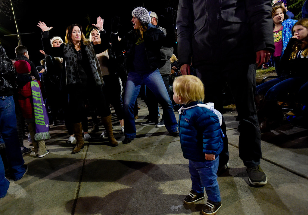 . BB Fitzhugh, 19 months, watches as Rebekah Waites, of Los Angeles, California, right, dances, before the annual tree lighting in Longmont, Colorado on Nov. 24, 2017. (Photo by Matthew Jonas/Times-Call)