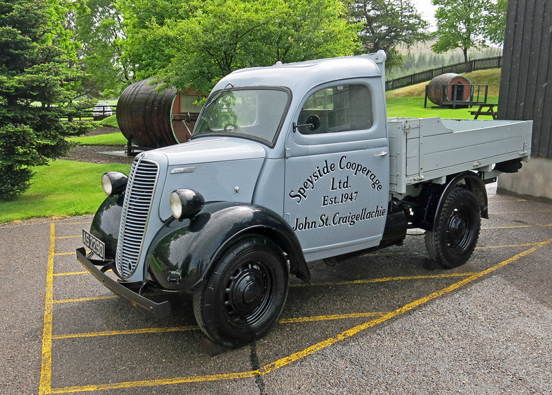 A beautifully restored old delivery truck.