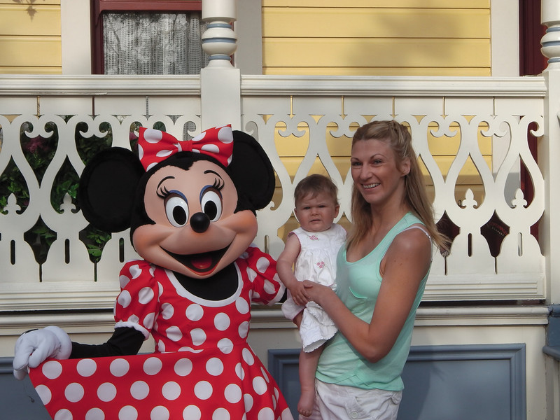 Eva meets Minnie - That's actually a smile developing...<br /> As expected Eva frowned then pulled Minnie's whiskers and then tried to bite her nose!