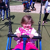Eva enjoying the swings at Cotswold Wildlife Park