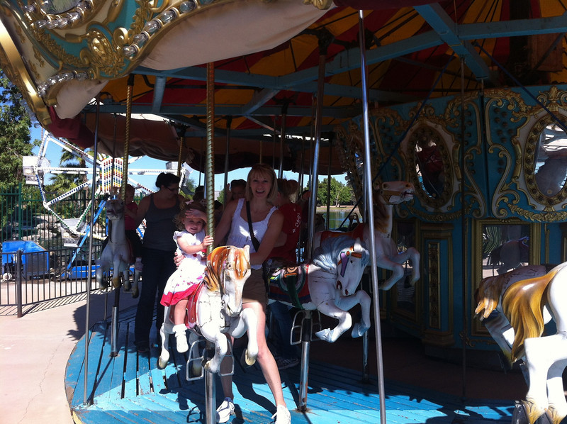 Catherine and Eva on the carousel at Freestone Park.