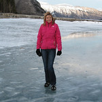 Catherine walks on the frozen Lake Minnewanka