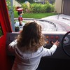 Eva driving Postman Pat's van at CBeebies Land at Alton Towers.