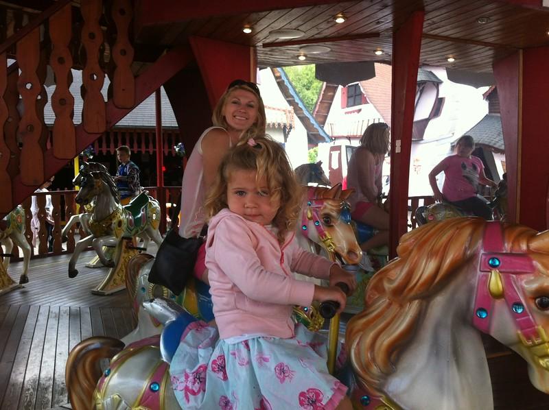 Eva & Catherine riding the Horses Carousel at Gulliver's World Warrington.