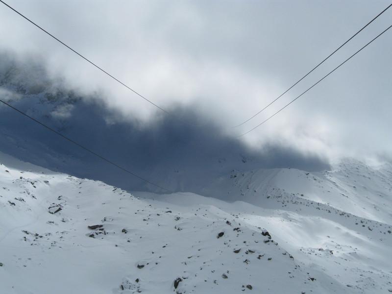 The support and tractor cables for Téléphérique de l'Aiguille du Midi disappear into the clouds