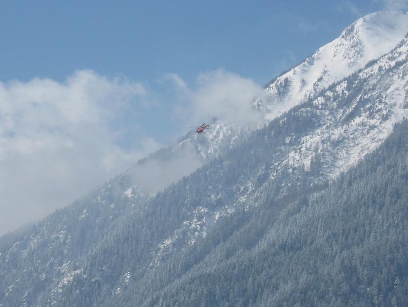 A ski equipped Alouette III heading towards the hospital
