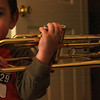 My Nephew figuring out how to hold the Trumpet Correctly.