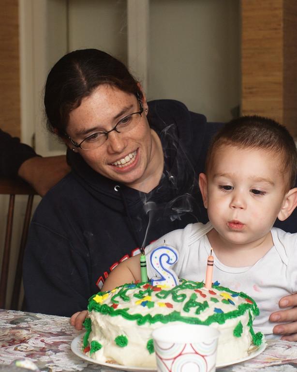 My Nephew Brendon Extinguishing his candles on his birthday cake.