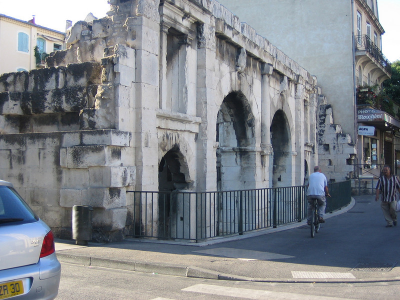 Ruin of a roman city gate. Nimes was a Roman city and still has ruins of gates to the ancient city and old towers scattered throughout the city.