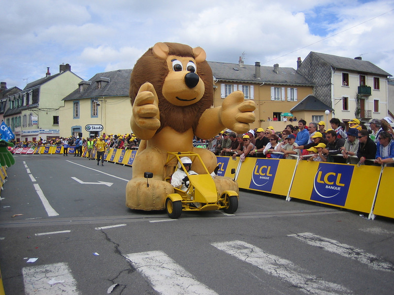 LCL mascot is a lion. This lion rides a dunebuggy.