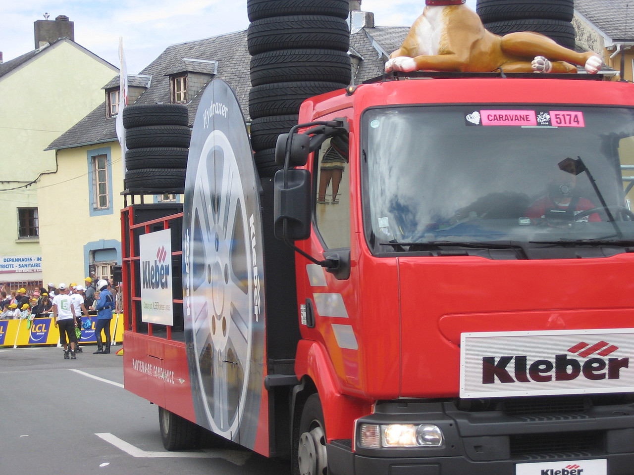 This truck throws inflatable tires at people in the crowd.