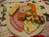 My plate: Ham, turkey, red leicester cheese, cheshire cheese, cheddar cheese with garlic and herbs, lettuce, tomato, sausage roll, potato salad with garlic mayo, Coleman's mustard and salad cream, naturally :-)