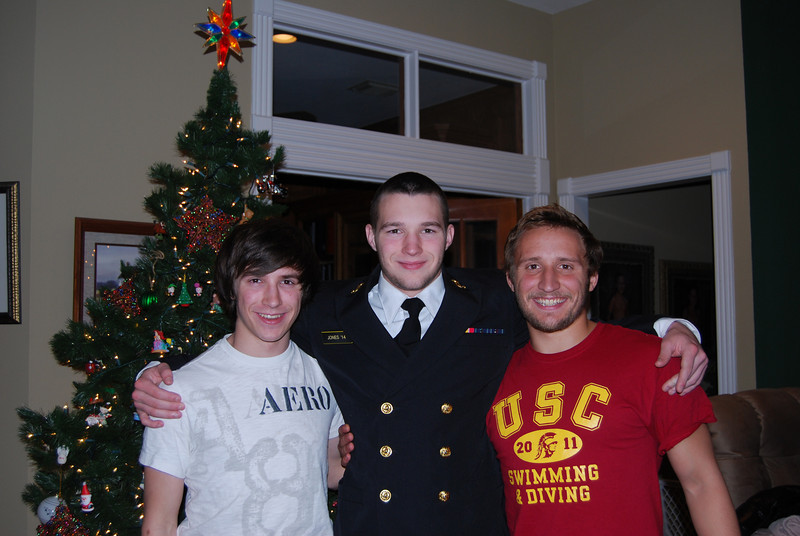 Hayden in his dress blues with his brothers.  Hayden's brothers are so proud of him.