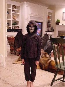 Connor - As a Skeleton Creature for a costume contest in his Musical Theater class.  (GREAT MAKE-UP JOB, DAD!!!!)