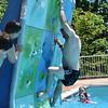Debby High — For Montgomery Media<br /> Chris Politi, of Perkasie, climbs up the rock wall at Menlo Aquatics Center.