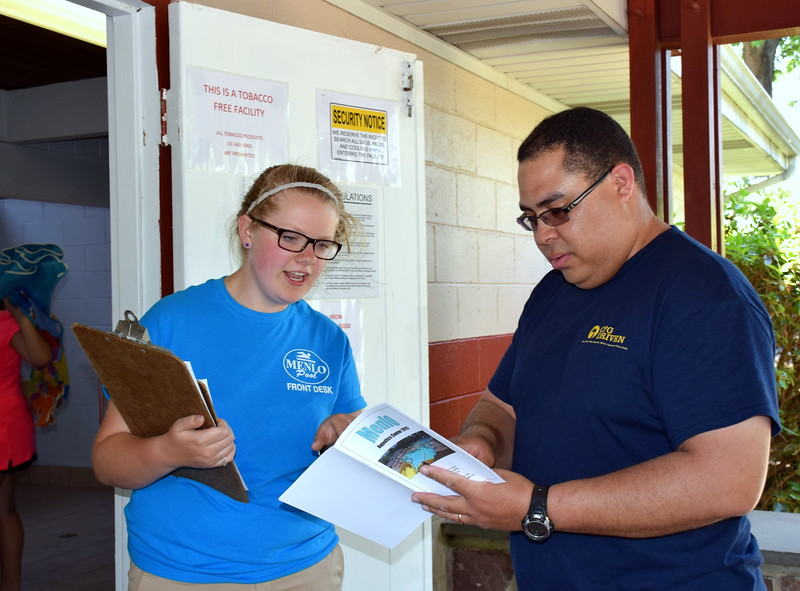 Debby High — For Montgomery Media<br /> Sarah Heitzenrater explains the Menlo Aquatics Center membership to Nelson Westerband, a new Perkasie resident.