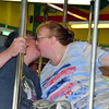 Debby High — For Montgomery Media<br /> Kevin and Heather Kerns kiss while riding the Perkasie Carousel on Memorial Day.